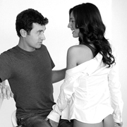 black and white photo, clothed couple, woman caressing her man's penis