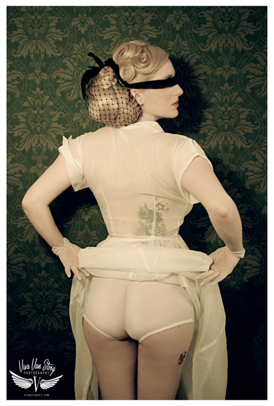 Viva Van Story Photograph blindfolded woman facing wall with bottom on show